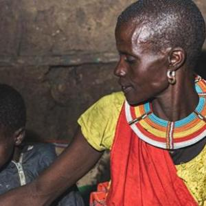 A woman and her three young boys sit together in Samburu, Kenya in January, 2020