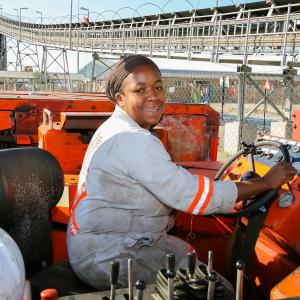 Johannesburg, South Africa - August 11 2008: Underground Platinum Palladium Female Miner operating vehicle machinery used to move ore rocks