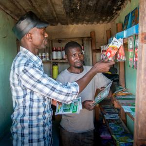 Photo: Two men from the Yapasa Project standing in a store. Photo Credit: Photo Yapasa Project 2017