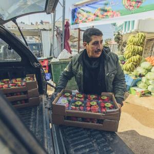 Hussein Ahmad Qararya is a strawberry vendor in West Bank.