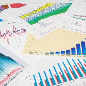 Photo: Stock image of stack of charts and graphs