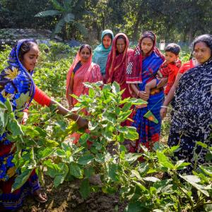 Photo: Women work a a farm. Photo Credit: WorldVision
