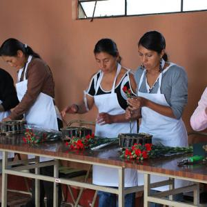 Group of Guatemalan women being taught how to create floral designs. Photo: Michelle Los Banos-Jardina, USUN Rome.