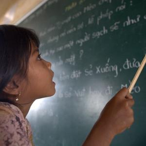 Photo: A student of Khmer descent learns Kinh.