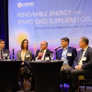 Photo description: Panelists speak at the renewable energy and smart grid suppliers forum. Credit: Cory Ragsdale / Training Resources Group