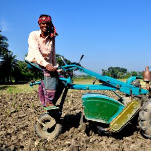 A farmer in southern Bangladesh uses farming equipment