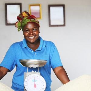 Photo: A young entrepreneur balancing scales