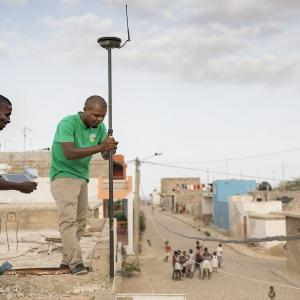 Photo: Technicians Ismael Rodrigues (left) and Jose Silva (right) work to survey and geomap a property on the island of Maio as part of the MCC-Cabo Verde Compact. Accurate information about land rights and ownership is important to facilitating private investment in Cabo Verde, where tourism is a major driver of the economy.