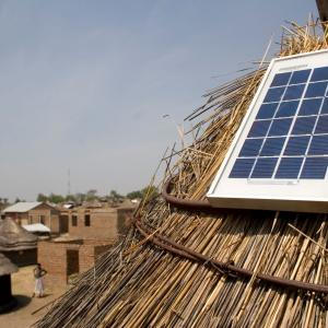 Photo description: A solar panel on the roof of a home in Kenya.