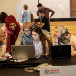 Photo description: UN Women volunteers edit and translate articles on Arabic Wikipedia in Egypt. Credit: Emad Karim/UN Women.