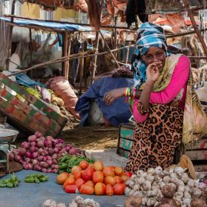 Photo: Young woman working at a local market in Addis Ababa, Ethiopia
