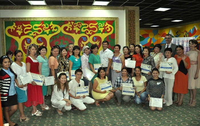 The group stands with certificates.